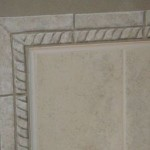 Close up of stenciled bullnose tile