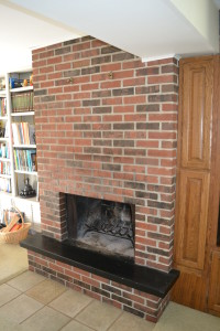 Fireplace before brick refinishing