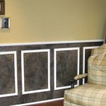 Torn paper on wainscoting